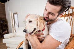 Man holding puppy Royalty Free Stock Photography