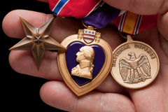 Man Holding Purple Heart, Bronze and National Defe Royalty Free Stock Images