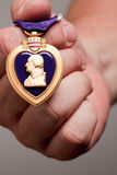 Man Holding Purple Heart War Medal Royalty Free Stock Photo