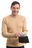 Man holding purse with money Royalty Free Stock Photos