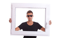 Man holding a pvc window frame Stock Images