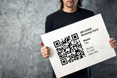Man holding QR code business card Stock Image
