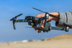Man holding quadcopter drone Stock Photo