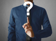 Man holding question mark Royalty Free Stock Photos