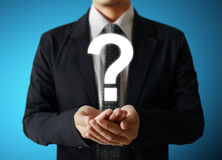 Man holding question mark Royalty Free Stock Images