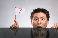 Man holding question mark flag Stock Photos