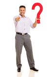 Man holding question mark Stock Images