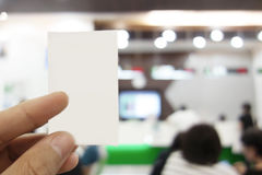 Man is holding queue card in the bank. Stock Image