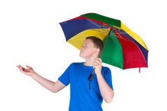 Man holding a rainbow coloured umbrella Stock Images
