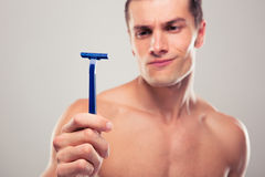 Man holding razor Stock Photos