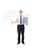 Man holding a recycle bin and a blank banner Stock Images