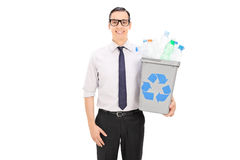 Man holding a recycle bin full of plastic bottles Royalty Free Stock Image