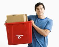 Man holding recycling bin. Stock Photos
