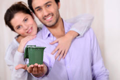 Man holding recycling bin Royalty Free Stock Photography