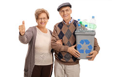 Man holding recycling bin and woman giving thumb up Stock Photo