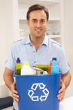 Man Holding Recyling Waste Bin At Home. Smiling Royalty Free Stock Images