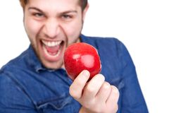 Man holding red apple Royalty Free Stock Images