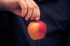 Man holding red apple hand Royalty Free Stock Photography
