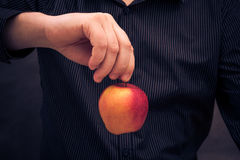 Man holding red apple hand Stock Image