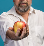 Man holding red apple in hand Royalty Free Stock Photography