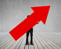 Man holding red arrow up sign Stock Image