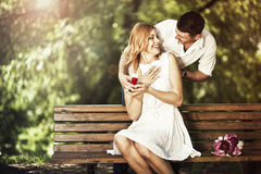 Man holding red box with ring making propose to his girlfriend. Outdoors royalty free stock photos