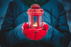Man holding a red candle lantern with a candle close up Stock Photos