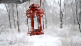 Man holding a red candle lantern in the winter forest. Snow forest snowfall. Man holding red candle lantern in winter forest. Snow forest snowfall. HD 1080 stock footage