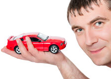 A man holding a red car Stock Photo