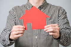 Man holding red house model. Man holding red cardboard model of house. Concept for mortgage loan for home Royalty Free Stock Images