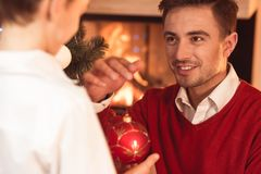 Man holding red Christmas bauble royalty free stock photos