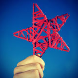Man holding a red christmas star Stock Images