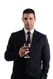 Man holding a red glass of fine wine Royalty Free Stock Image
