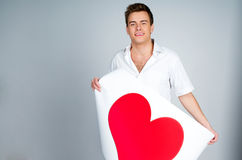 Man holding a red heart Royalty Free Stock Photos