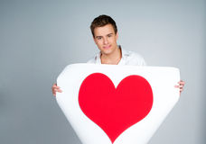 Man holding a red heart Stock Photography