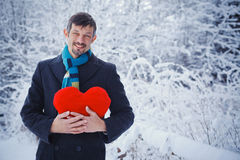 Man holding red heart Royalty Free Stock Image