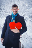 Man holding red heart Royalty Free Stock Photography