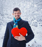Man holding red heart Stock Images