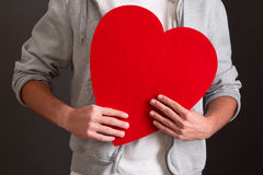 Man holding red heart - love Stock Photos