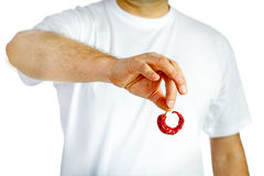 Man holding red hot chili pepper Royalty Free Stock Photos