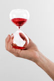 Man holding a red hourglass Royalty Free Stock Photos
