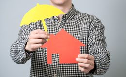Man holding red house model Royalty Free Stock Photo
