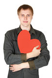 Man holding red paper heart and smiling Stock Image