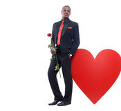 Man holding red rose and posing at studio. Royalty Free Stock Photos