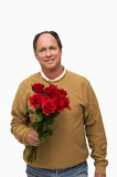 Man Holding Red Roses. A middle-aged man holds a bouquet of red roses Stock Image