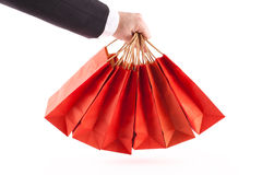 Man holding red shopping bags Royalty Free Stock Images
