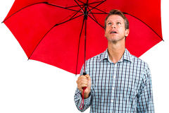 Man holding red umbrella Royalty Free Stock Photos