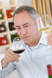 Man holding red wine cup in wine tasting. Man holding red wine cup in a wine tasting Royalty Free Stock Photos