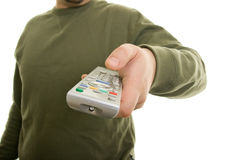 Man holding remote control. A man holding remote control Royalty Free Stock Photo