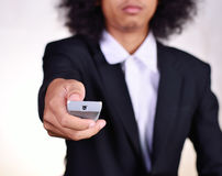 Man holding remote control Stock Images